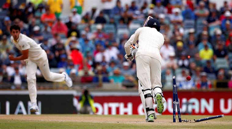 Australia's Mitchell Starc celebrates after bowling England's James Vince