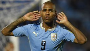 Uruguay's forward Diego Rolan celebrates after scoring against Colombia
