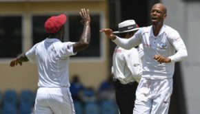 Roston Chase celebrates the dismissal of Niroshan Dickwella of Sri Lanka