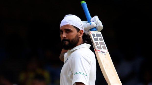 Murali Vijay of India raises his bat