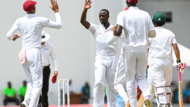 Kemar Roach of West Indies celebrates the dismissal of Tamim Iqbal of Bangladesh
