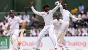 Sri Lankan cricketer Akila Dananjaya celebrates after he dismissed South Africa's Theunis de Bruyn