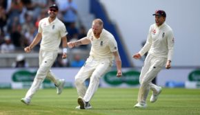 Ben Stokes of England celebrates with James Anderson and Joe Root after dismissing Mohammed Shami