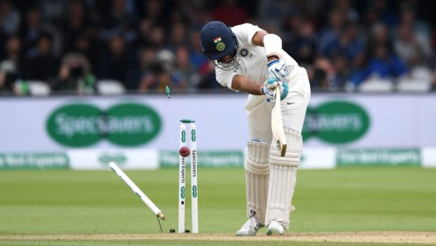 Pujara of India is bowled by Stuart Broad of England