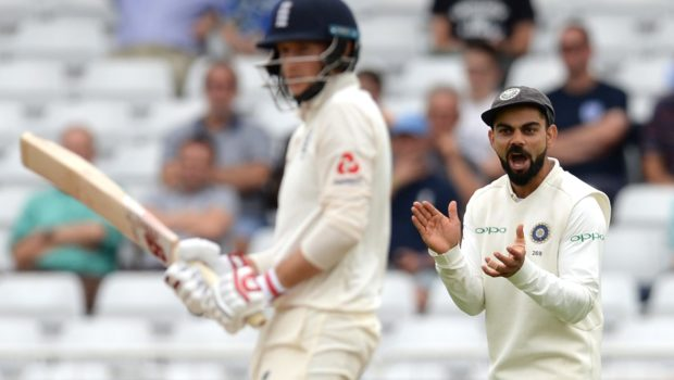 Virat Kohli of India claps his hands as Joe Root of England