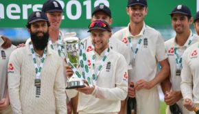 Joe Root of England holds aloft the Winner's Trophy