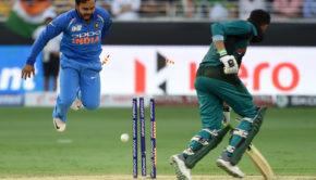 Pakistan batsman Shoaib Malik runs out as Indian cricketer Kedar Jadhav