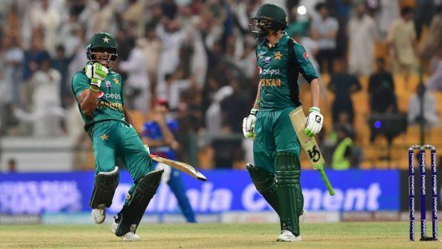 Pakistan's Hasan Ali celebrates with Shoaib Malik