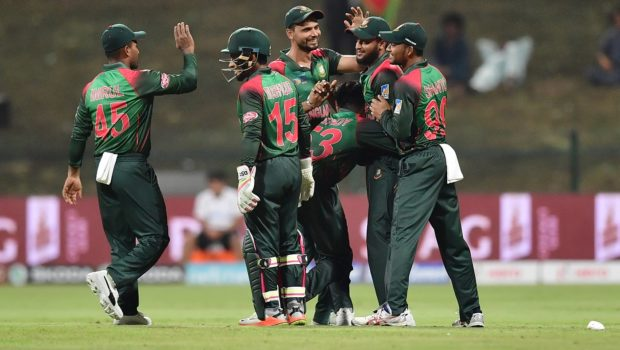 Bangladesh Nazmul Islam celebrates with his team