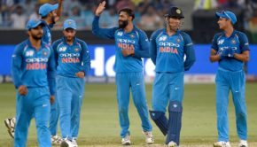 Indian cricketer Ravindra Jadeja celebrates with teammates