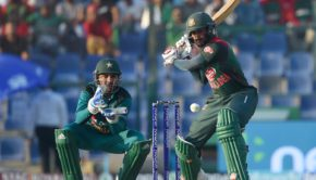 Bangladesh batsman Mohammad Mithun plays a shot as Pakistan captain Sarfraz Ahmed looks