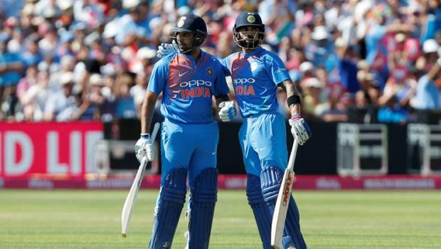 ndia's Rohit Sharma celebrates with Virat Kohli after reaching a half century