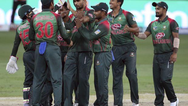 Bangladesh's captain Mashrafe Mortaza, center, celebrates with teammates