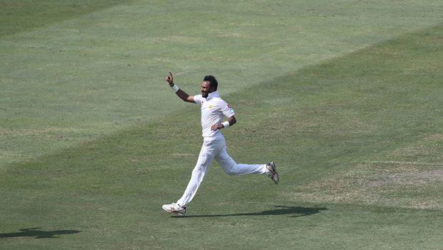 Pakistan cricketer Bilal Asif celebrates after taking the wicket of Australian batsman Usman Khawaja