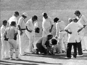 Duleep Mendis receives medical treatment after being hit on the head by Jeff Thomson