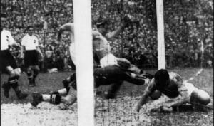 Ten minutes into their 1934 World Cup semi-final against Austria at the San Siro in Milan, Enrico Guaita bundles the ball home to score the only goal of the game. Photograph: Keystone/Getty Images