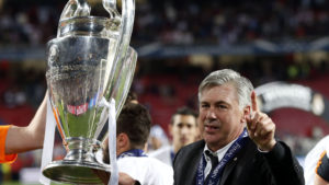 Carlo Ancelotti holding the Champions League Trophy at Lisbon in 2014. Image Courtesy: Marca