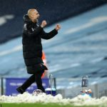 Pep Guardiola celebrates after the final whistle