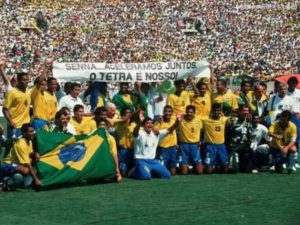 Brazilian players draw the reverence banner for Senna after winning the 1994 World Cup. Image Courtesy: royalgazzatte.com